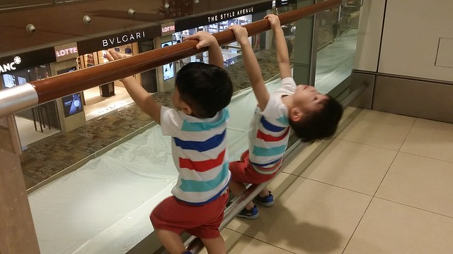 The 2 brothers, swinging off the handle bar