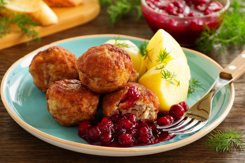 Hot meatballs with boiled potatoes and cranberry sauce ..