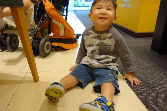 Happy kid sitting on the floor!
