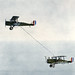 Two Airco DH-4B biplanes of the United States Army Air Service perform the first ever mid-air refueling on June 27, 1923 by Jared Enos