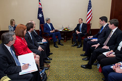 Australian Prime Minister Tony Abbott addresses U.S. Secretary of State John Kerry during statements to the media before a bilateral meeting following their attendance at the inauguration ceremonies for Indonesian President Joko Widodo in Jakarta, Indonesia, on October 20, 2014. [State Department photo/ Public Domain]