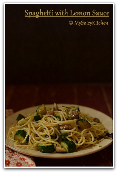 Spaghetti al Limone or Pasta in Lemon Sauce served in a plate.  It is a moody image