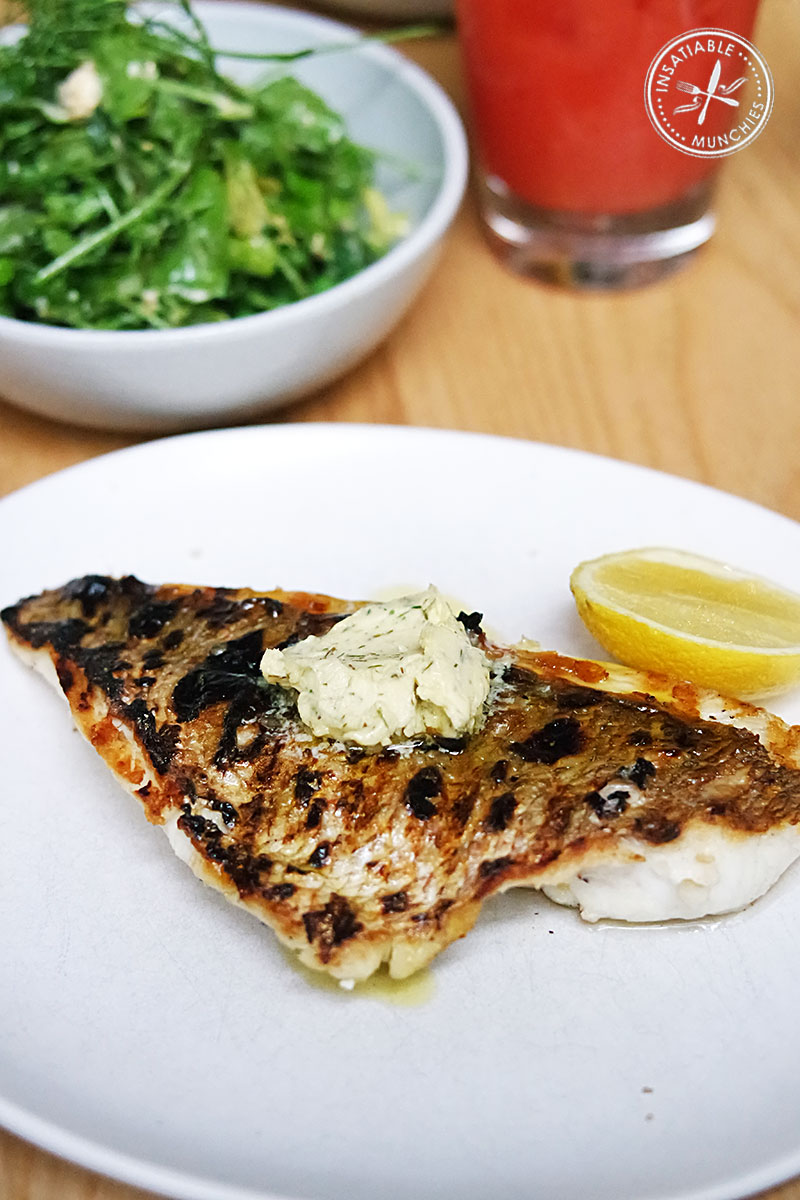 Wood-roasted snapper with wild fennel butter, spring vegetables and shanklish
