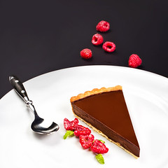 Delicious Piece of Chocolate pie  with fresh red b…