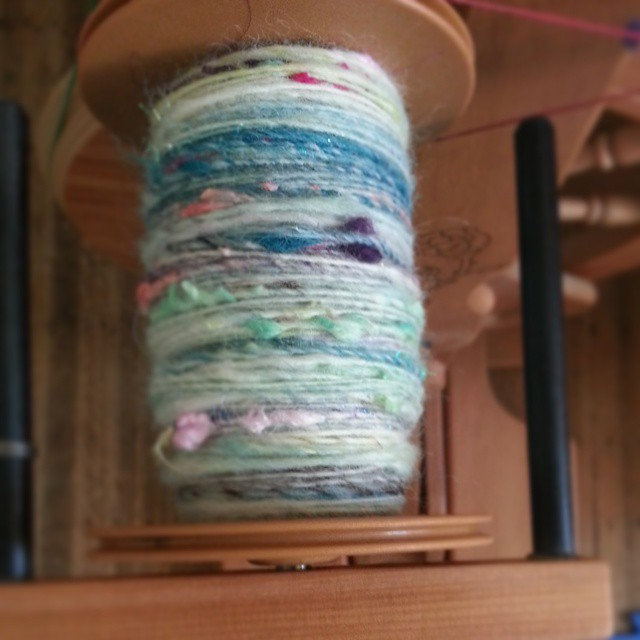 Half of my textured #rolags spun up #spinnersofinstagram #spinstagram
