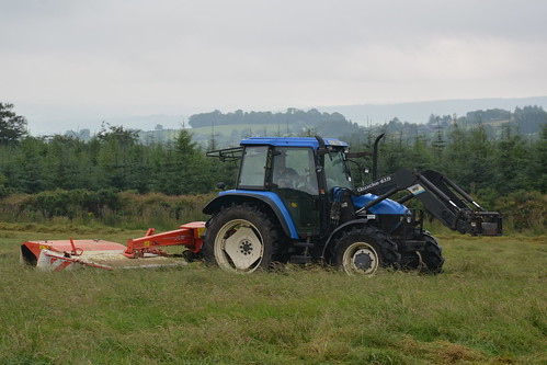 New Holland TS Tractor with a Kuhn FC 283 Mower Conditioner