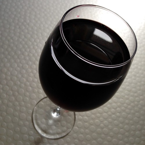 Red wine. Wine.  Wine glass.  Swirling glass.