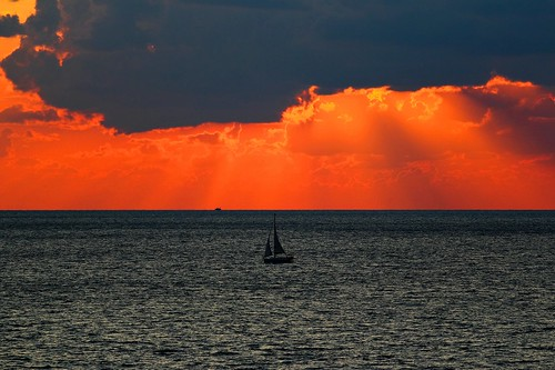 sunset sea orange beach silhouette clouds sailboat canon israel telaviv sailing seascapes cloudy horizon telephoto orangesky canondslr telephotolens canon70200f4l orangesunset cloudysunset horizonbeach canon600d canonkiss5