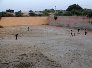 The bed of Shivbari pond remains dry. Children use it as a cricket pitch.