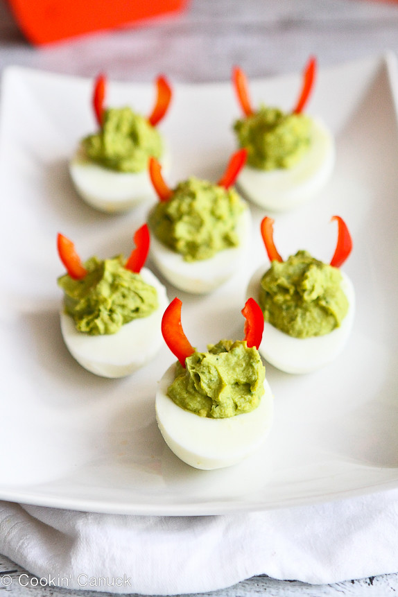 Devilish Avocado Sriracha Deviled Eggs...A fun and healthy snack for Halloween! 52 calories and 1 Weight Watchers point per serving. | cookincanuck.com #recipe #appetizer #vegetarian #glutenfree