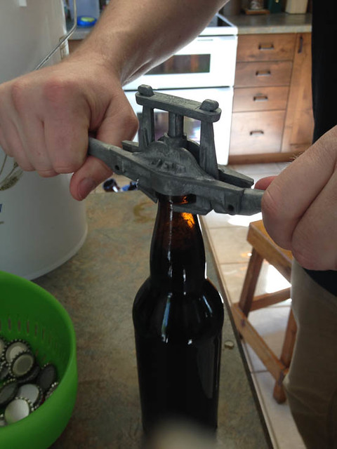 capping bottles homebrewing.jpg