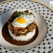 Deconstructed stir fried rice with chicken (dark meat) and topped with a sunny side quail egg