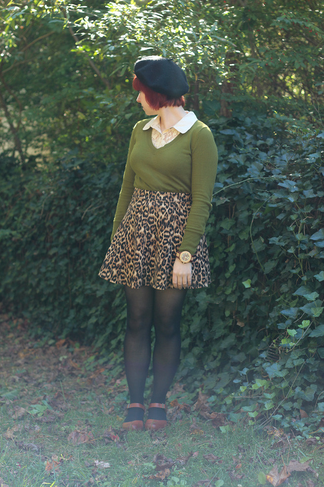 Green Sweater over a Lace Top, Leopard Skirt, Clogs, Black Beret, and Wood Wristwatch