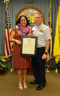 Michelle Sneller poses with her husband, Chief Petty Officer Jerrod Sneller, after being recognized as the Coast Guard recipient of the 2014 Hawaii Outstanding Military Spouse Award during a ceremony at Honolulu City Hall, Oct. 30, 2014. Recipients of this year's awards have functioned as the volunteer communication and organizational focal point for units that were or still are deployed in the theater of hostile operations during the calendar year of 2014. (U.S. Coast Guard photo by Seaman Lauren Steenson)