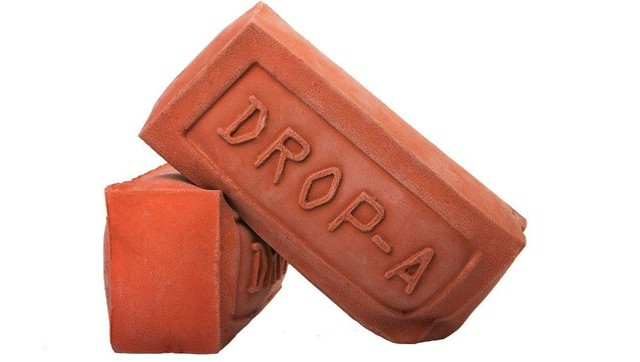 Drop-A-Brick is made of a sustainable bio-based rubber and helps save water in toilets
