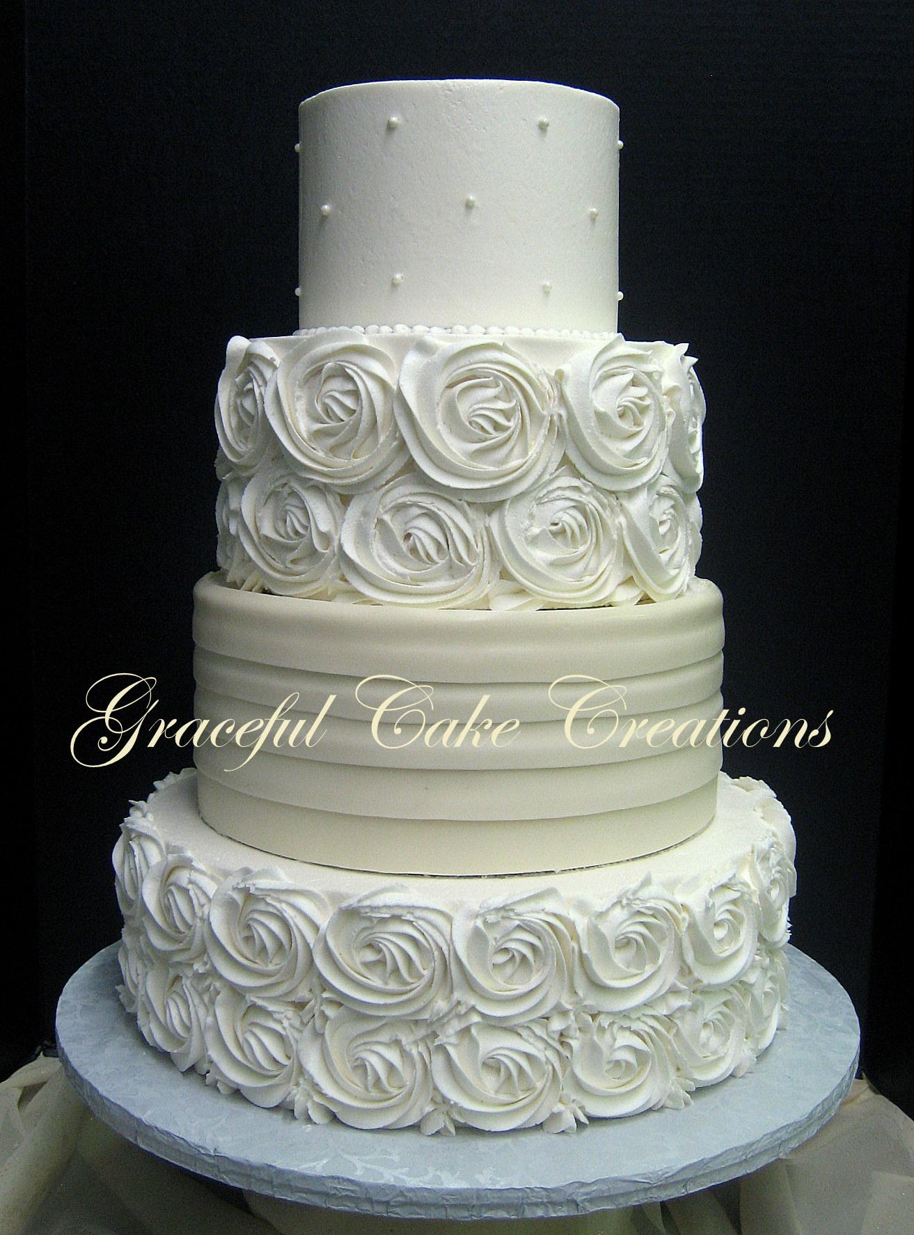 Elegant Ivory Wedding Cake with Rosettes