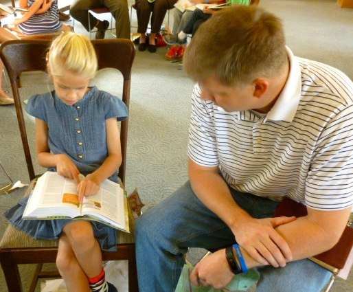 a child checks out the Bible notes