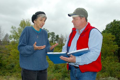 Theresa Lackey talks to NRCS District Conservationist Tony Hoover about planned improvements to her land. (NRCS photo)