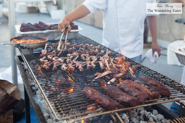 Grilling up Colorado lamb ribs at  Knife Dallas stall