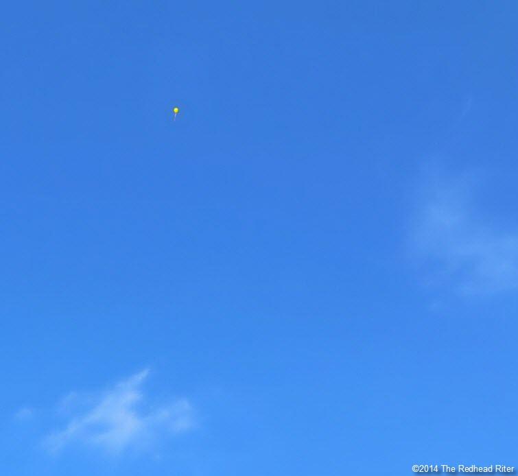 yellow balloon in blue sky