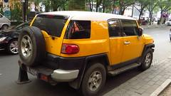 off-roading(0.0), automobile(1.0), automotive exterior(1.0), sport utility vehicle(1.0), wheel(1.0), vehicle(1.0), toyota fj cruiser(1.0), compact sport utility vehicle(1.0), bumper(1.0), land vehicle(1.0),
