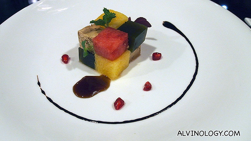 Cubes of Duo Watermelon - red and yellow watermelon with feta and mint gelee, pomengranate, balsamic reduction