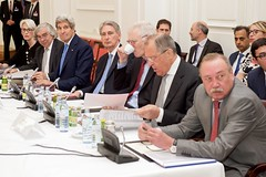 U.S. Secretary of State John Kerry, flanked by Under Secretary of State for Political Affairs Wendy Sherman and U.S. Energy Secretary Dr. Ernest Moniz, sits with British Foreign Secretary Philip Hammond and Russian Foreign Minister Sergey Lavrov on July 6, 2015, in Vienna, Austria, during a plenary session of the P5+1 member countries amid negotiations with Iranian officials about the future of their country's nuclear program. [State Department photo/ Public Domain]